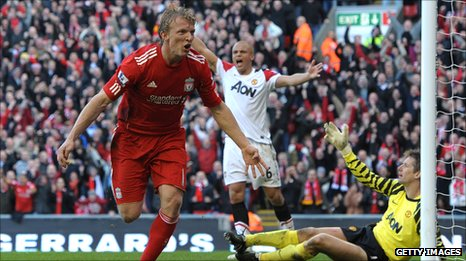 Dirk Kuyt celebrates scoring past arch rivals Manchester United at Anfield