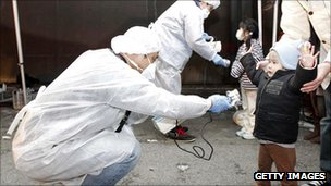 Officials in Japan check for signs of radiation on children