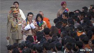 King Jigme Khesar Namgyel Wangchuck and Queen Jetsun Pema greet villagers after their wedding