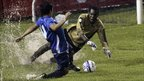 El Salvador's Romeo Monteagudo (left) fights for the ball with Cayman Island's Ramon Sealy during a World Cup 2014 qualifying match in in San Salvador 11 October 2011.