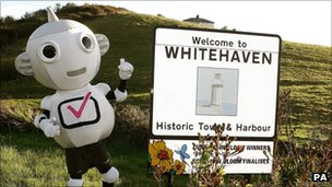 Switchover mascot Digit Al at Whitehaven town limits