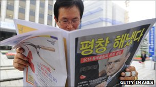 Man reading a newspaper in South Korea