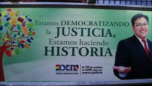 Election poster: &quot;We are democratising justice, we are making history&quot;