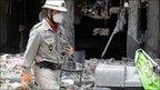 Firefighters inspect scene of the blast in Rio