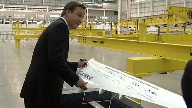 David Cameron signing a model wing