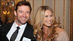 Hugh Jackman and Elle Macpherson wait to meet the Queen.