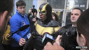 Phoenix Jones, aka Ben Fodor, speaks with reporters 13 October 2011