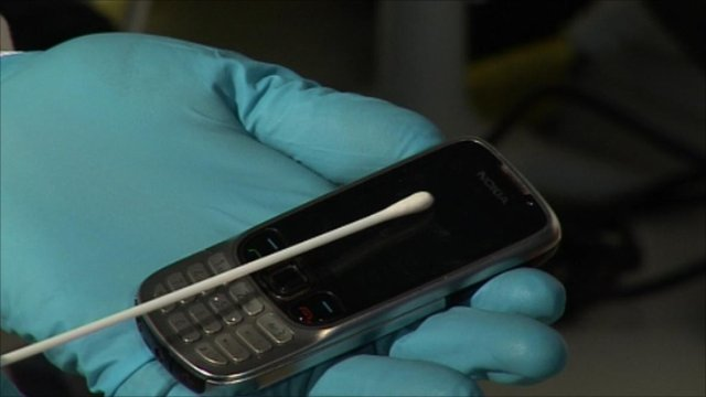 A phone being swabbed