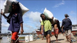 File image of labourers carrying sacks in Rangoon on 3 September 2011