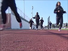 Teenagers sprinting on athletics tracks