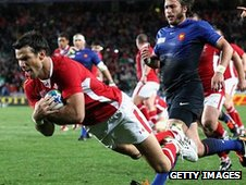 Mike Phillips dives over to score Wales' try