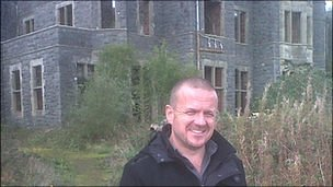 Aaron Hill in front of Plas Gwynfryn