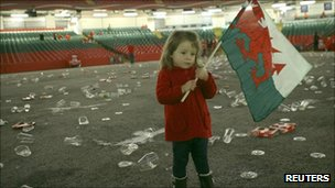A three year old girl still holding the flag after the defeat
