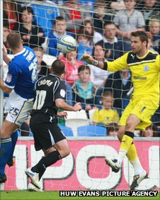 Ipswich striker Michael Chopra heads in at the far post