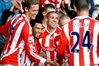 Jon Walters celebrates with Stoke teammates