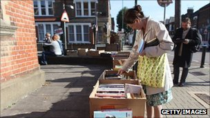 Resident looks at donated books outside Kensal rise library