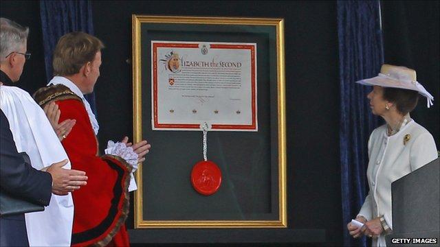 Princess Anne unveils the Royal patent