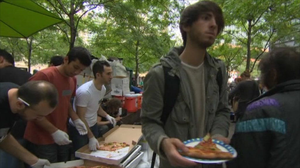 Protester eating pizza in New York