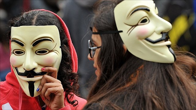 Two protesters in London, taking part in a global day of anti-capitalism protests October 16, 2011