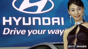 Woman with banner for Hyundai