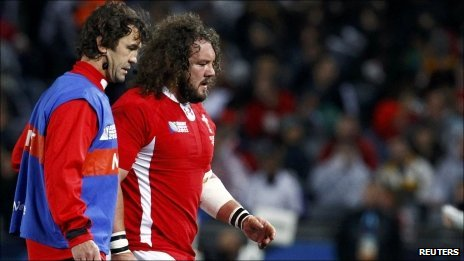Injured prop Adam Jones leaves the field during the World Cup semi-final