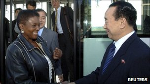 Valerie Amos, UN under-secretary-general for humanitarian affairs, and her party are greeted by a North Korean official upon their arrival at an airport in North Korea on Monday, in this picture released by North Korea's official news agency KCNA