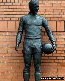 A statue of John Greig stands outside Ibrox Stadium