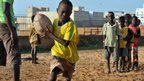 A Senegalese boy participates in rugby practice along with other youths at the House of Rugby (Maison du Rugby) sports and cultural centre, in Dakar, 17 October 2011
