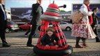 A four year old tries out a new Dalek toy in London 18 October 2011