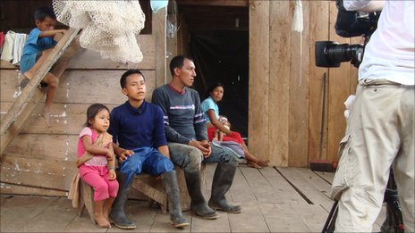 Family at home in Ecuador with BBC camera crew