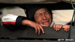 An Ethnic Hmong refugee sits inside a police truck during the operation to deport Hmong from Thailand