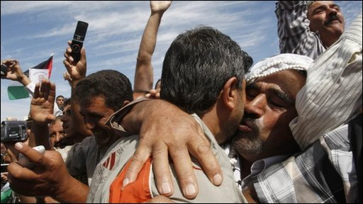 A newly released Palestinian prisoner is greeted by a relative in the West Bank city of Ramallah.