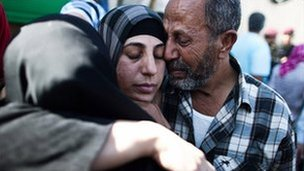 A Palestinian prisoner hugs relatives after arriving in Mukata following her release on October 18, 2011 in Ramallah, West Bank.