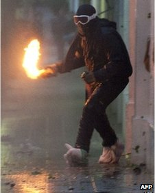 Protester throws petrol bomb in Santiago, Chile, on 18 October 2011
