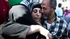 A Palestinian prisoner hugs relatives after arriving in Mukata, in the West Bank following her release (18 October 2011)