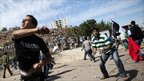 Palestinians clash with Israeli security forces at the Bitunia checkpoint in Ramallah, on the West Bank - 18 October 2011