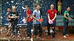 People throw water from bowls during the Songkran festival in in Luang Prabang