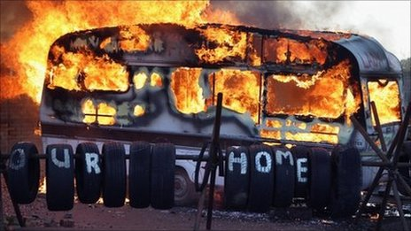 Flames engulf a caravan during evictions from Dale Farm travellers camp on 19 October, 2011