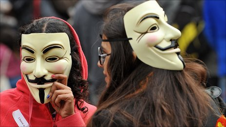 Protesters wearing Guy Fawkes masks gather outside St Paul Cathedral in the city of London on October 16, 2011 as part of a global day of protests inspired by the 'Occupy Wall Street' and 'Indignant' movements