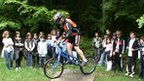 Children from Julien Absalon's former school perform bike skills