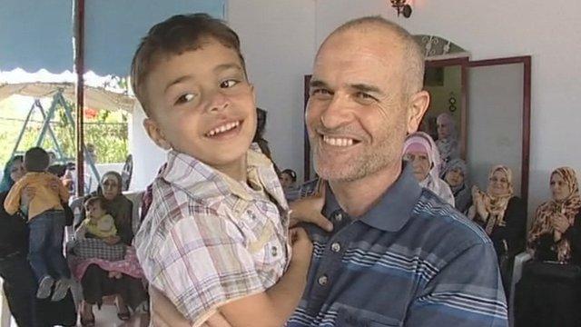 Former Palestinian prisoner holding a child