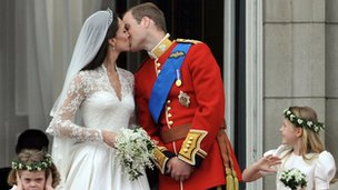 The Duke and Duchess of Cambridge kiss on the balcony of Buckingham Palace after the Royal Wedding 