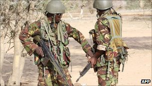 Kenyan soldiers talk as they prepare to advance near Liboi in Somalia, on 18 October 2011, near Kenya's border town with Somalia