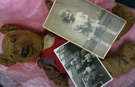 Teddy bear and childhood photos