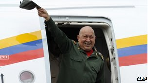 President Hugo Chavez waves from the plane on landing at the airport in Venezuela, on 20 October  2011.