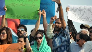 Pakistani journalists shout slogans during a protest supporting media rights in Islamabad on August 23, 2011.