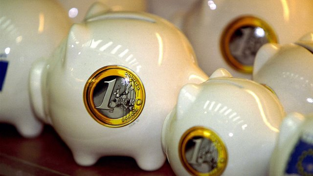 Piggy banks with picture of euro coin on side