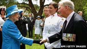 "Britain""s Queen Elizabeth II (L) meets with Arthur ""Bushy"" Pembroke (R) and his granddaughter, Staff Cadet Harriet Pembroke (2nd R), after presiding over the ""Presentation of the Colours"" to the Royal Military College, Duntroon in Canberra"
