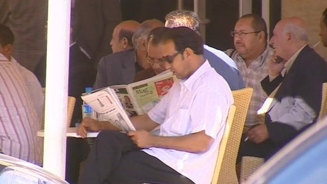 People read papers in cafe in Tunisia