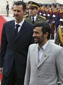 Bashar al-Assad (L) and Mahmoud Ahmadinejad (R) review honour guard in Damascus (January 2006)